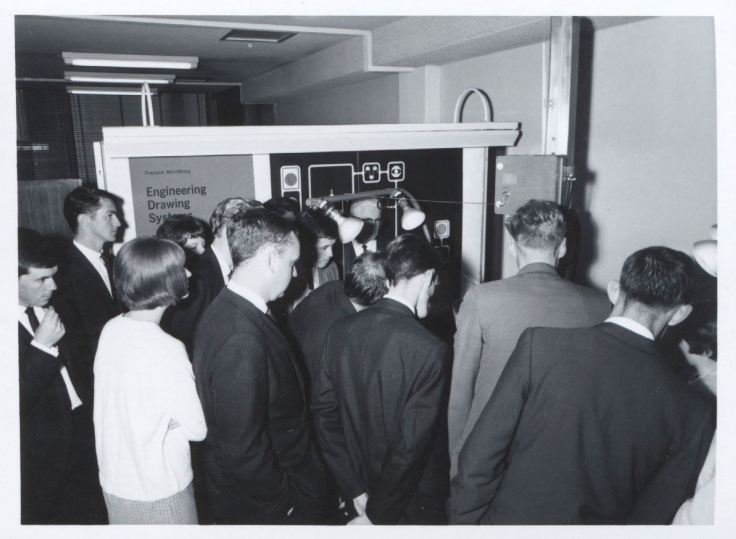 Crowd at Kodak Australasia viewing engineering drawing systems display, circa 1960s. Source Museum Victoria.