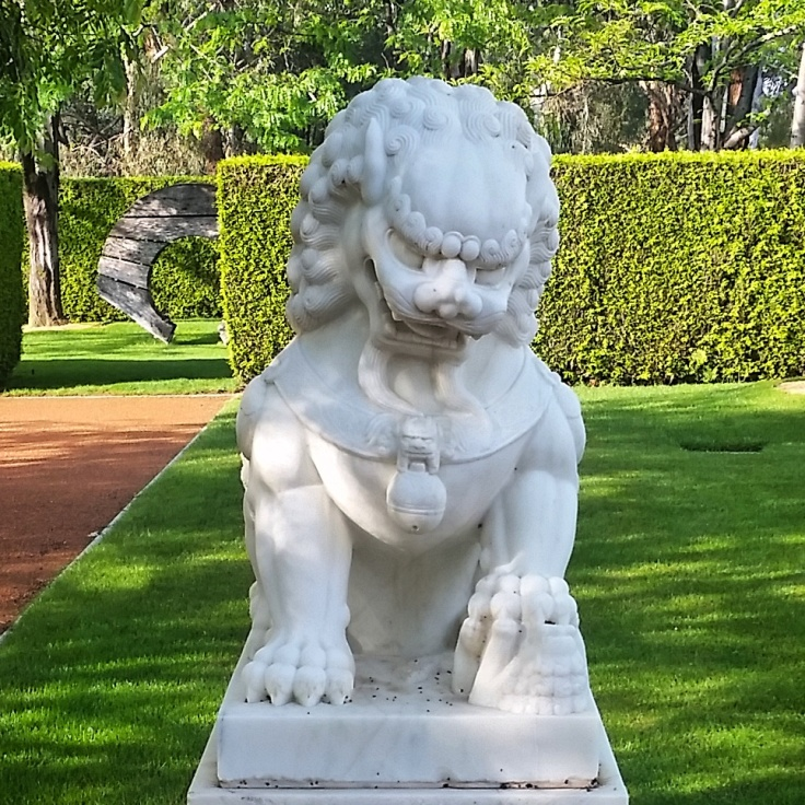 Lion statue in a garden on the House of Representatives side, Parliament house, Canberra, ACT. Photo © Jade Koekoe.