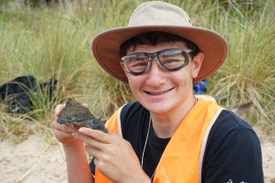 Tim with a fossil
