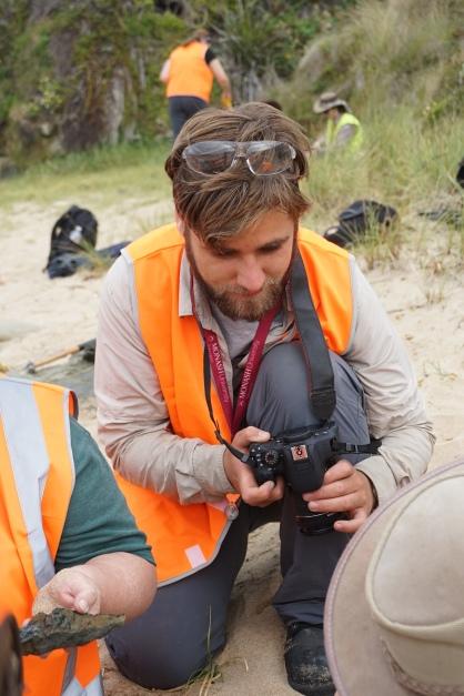 Callum taking pictures of fossils